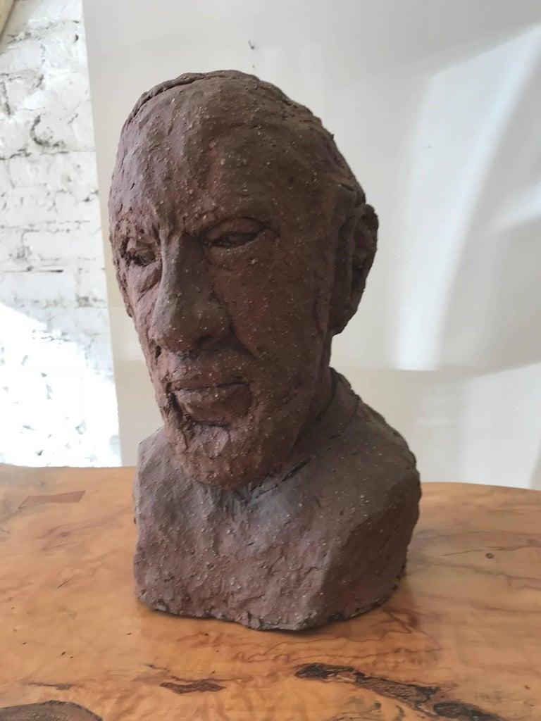 Wonderful rustic unglazed terracotta bust of a man by Joyce Pines a graduate of the Art Institute of Chicago. Pines studied under famed Czech sculptor Albin Polasek.  Intriguing ceramic decorative object from every angle.