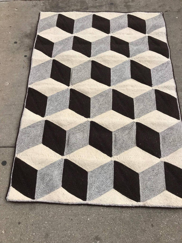 Large graphic tumbling block woven Jute fiber art wall hanging or rug. This tapestry has always been displayed on the wall never on the floor. It is in pristine condition. The optical effect om this contemporary rug is sensational.