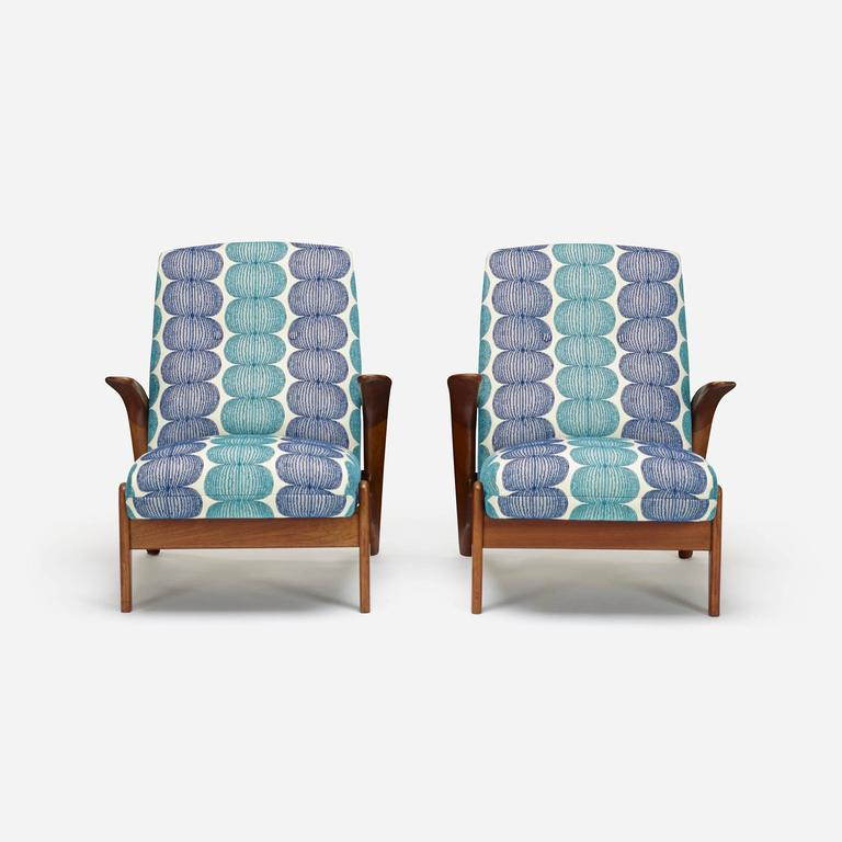 Newly reupholstered in a cheerful, Danish influenced textile. Quirky and comfortable, these chairs will brighten any room.