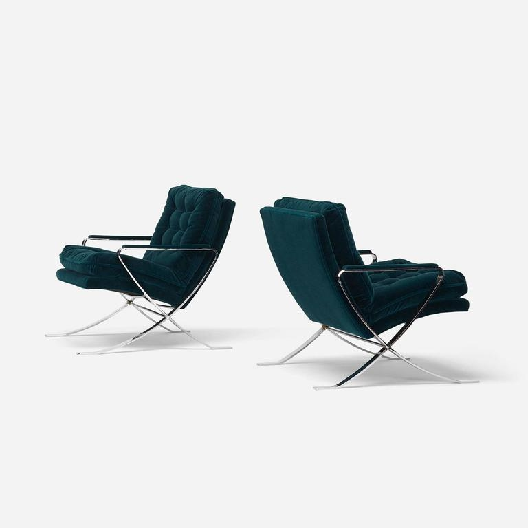 Chairs were recently updated in a rich, dark teal mohair.
