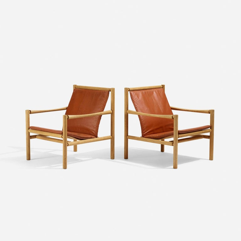 Soulful pair of leather and oak lounge chairs by Jorgen Nilsson.