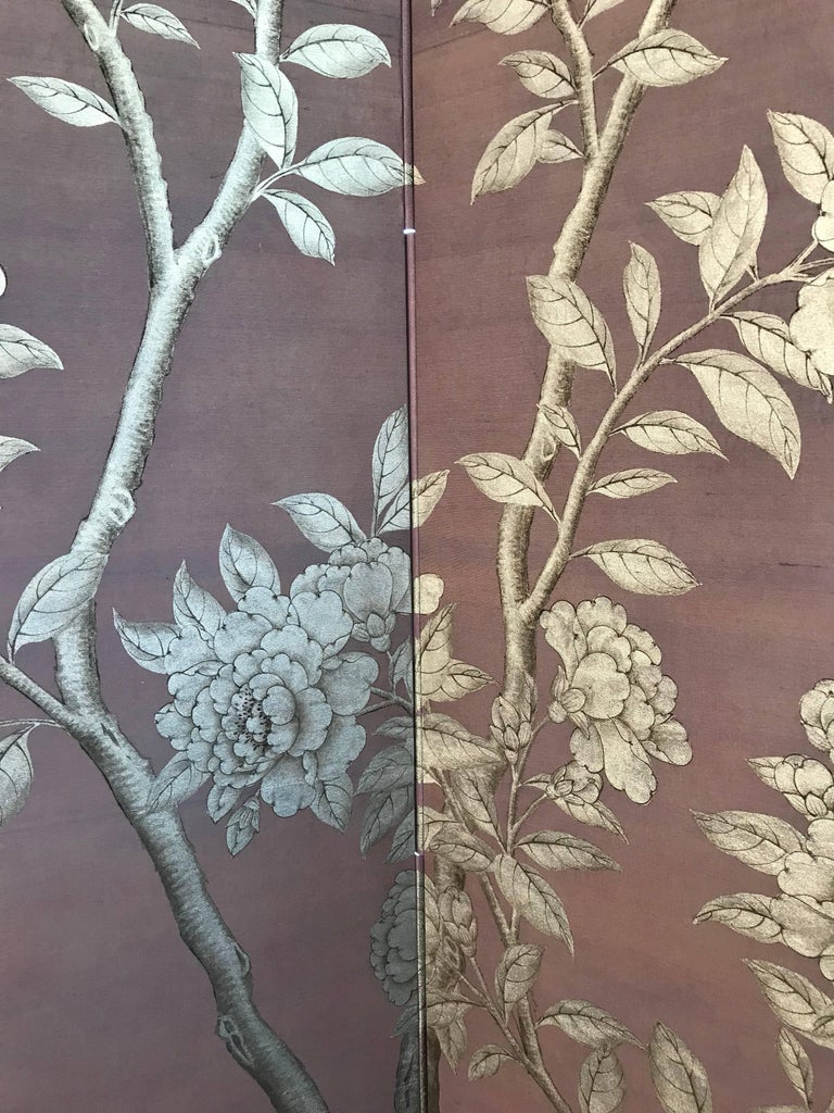 A luminous Gracie screen, with hand-painted design of flowering trees, birds and butterflies in silver with fine line details in black, on Lilac silk background.   Silk is also applied on the back, and the design continues through the hinges.