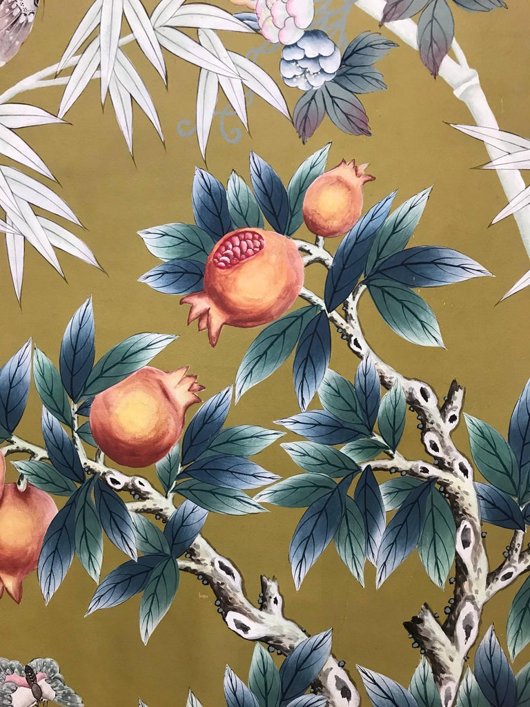 1970s hand-painted wall paper panel with balustrade, pomegranate plant in pot, bamboo, butterflies, and birds.   Please note: Overall measurements are 36 inches x 94 inches, however all edges of the panel will need to be trimmed 1/2 inch to remove