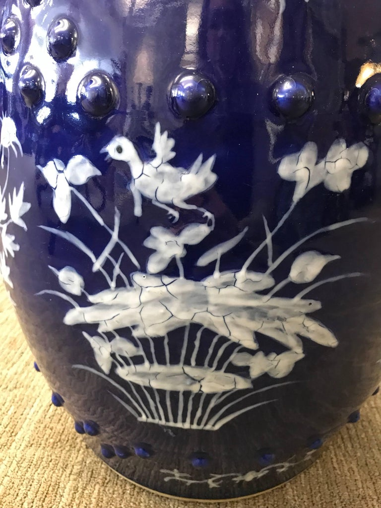 A Chinese blue and white garden seat with floral design.