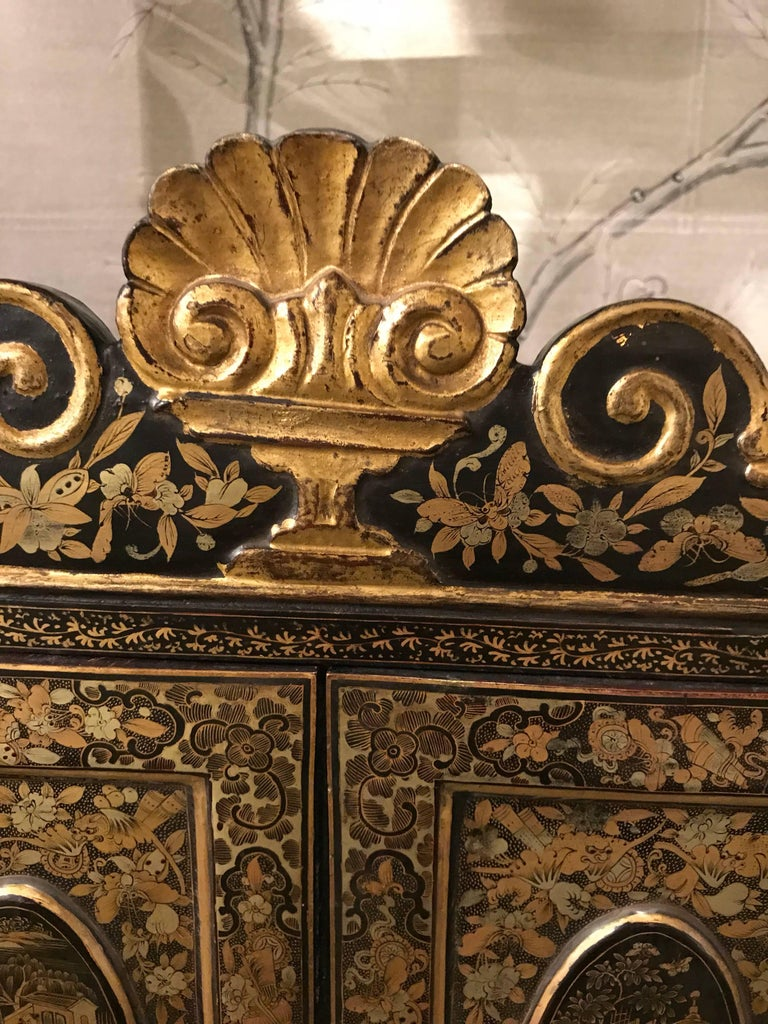 A small 19th century Chinese black lacquer export style cabinet.
