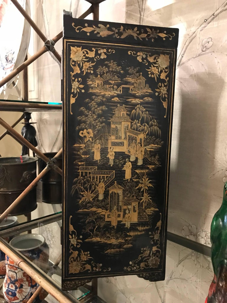 Black and Gold Lacquer Chinese Cabinet In Good Condition For Sale In New York, NY