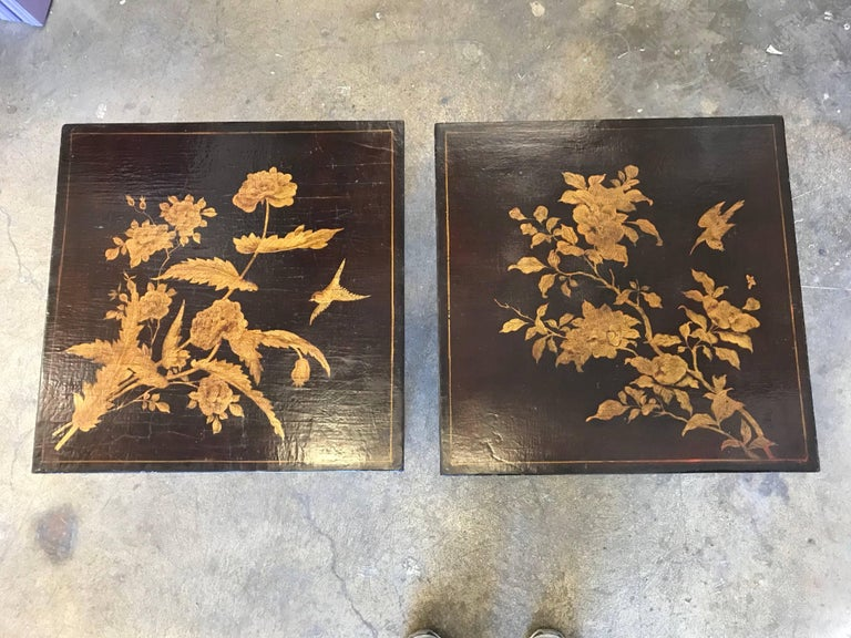 Pair of chinoiserie lacquered tables with metal bases.