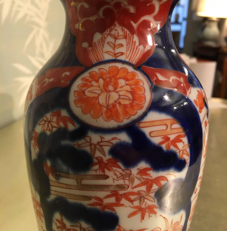 A pair of Japanese Late 19th century Imari vases with design of pine trees and bamboo.
