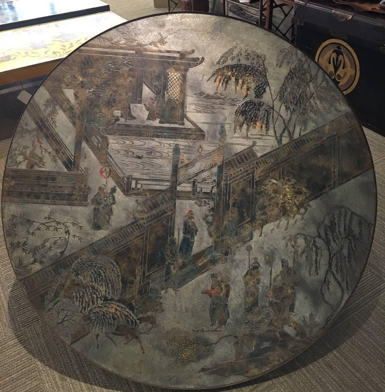 A large round Chan coffee table with figures and landscapes by Philip and Kelvin LaVerne. Signed by Philip and Kelvin LaVerne.