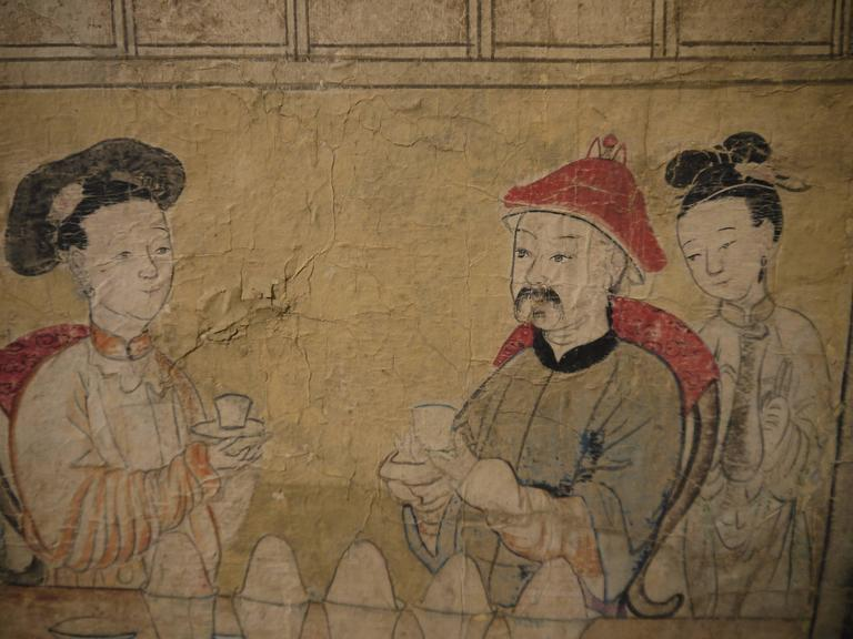 A beautifully hand-painted section of early 19th century, Chinese wallpaper.  Design of figures among buildings, with water and dramatic mountains.  Mounted on a muslin backing, but unframed.