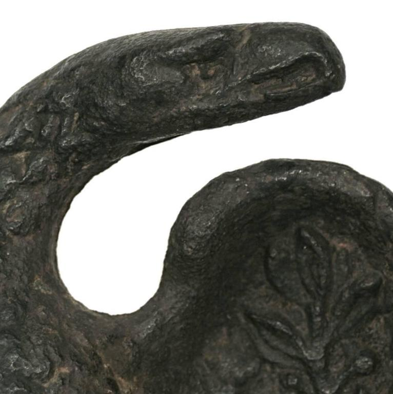 This cast iron eagle is one of the earliest sculptural forms that one will encounter in the marketplace. It is also one of the most attractive and iconic depictions of what some Americana enthusiasts call a snakehead or turkey head eagle.  The