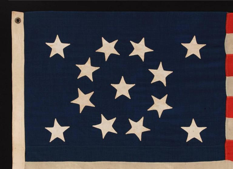 American 13 Hand-Sewn Stars in a Beautiful Medallion Configuration on a Small-Scale Flag For Sale