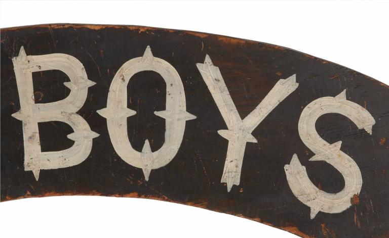 Black-painted American sign with beautiful lettering in a 19th century style, in a crescent-shaped design, probably made for over-door display. Dating shortly after the Civil War 1866-1880, the sign was made to honor Union Army & Navy veterans.