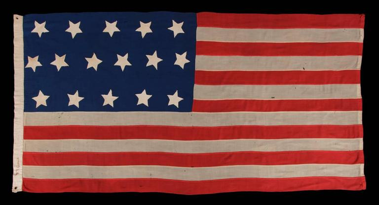 ENTIRELY HAND-SEWN ANTIQUE AMERICAN FLAG WITH 16 STARS, MADE DURING THE MID-19TH CENTURY, PERHAPS DURING THE CIVIL WAR PERIOD (1861-65) TO GLORIFY TENNESSEE AS THE 16TH STATE:   American national flag with 16 stars and 13 stripes, made sometime