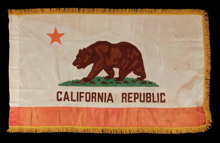 California State Flag, with especially attractive coloration and a gold silk fringe, made by Emerson Mfg. Co. In San Francisco, circa 1940-1950:  Early state flags fall between very scarce and extraordinarily rare in the antiques marketplace. One