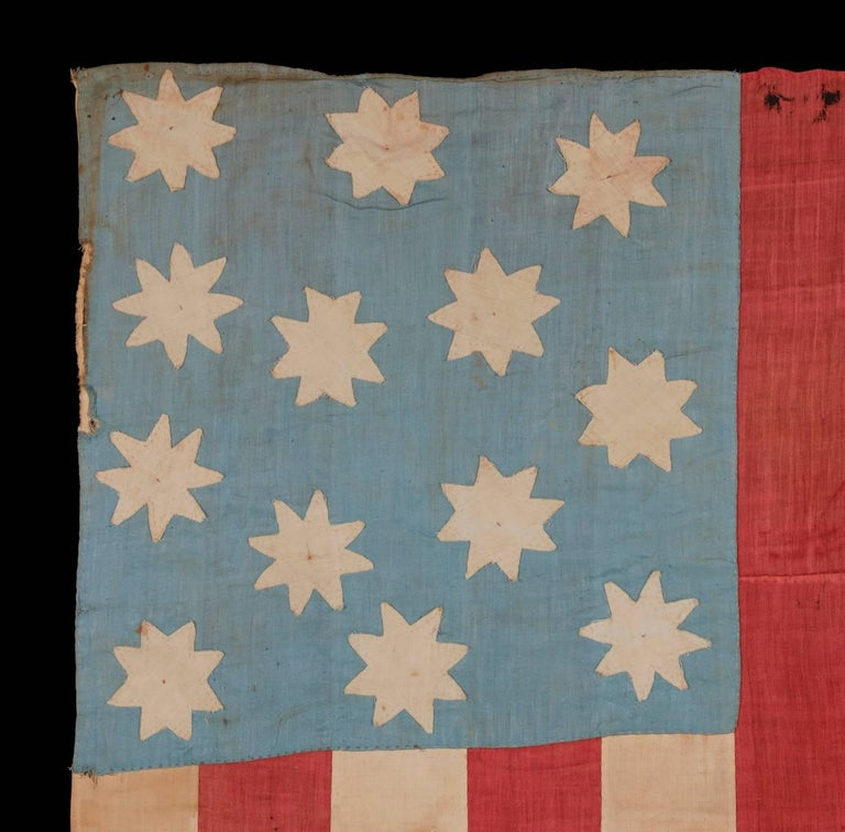 Extraordinary, hand-sewn, 13 star American national flag with 8-pointed stars on a glazed cotton, cornflower blue, 12 stripes and its canton resting on the war stripe, found in upstate, New York, pre-civil war, circa 1830-1850.