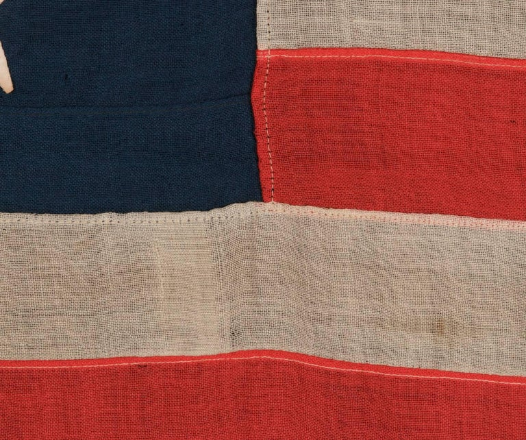 American 13 Hand-Sewn Stars In A Beautiful Medallion Configuration On An Antique Flag For Sale