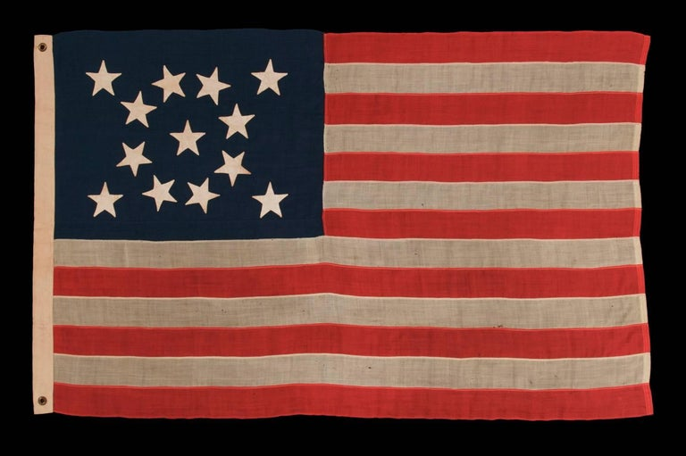 13 Hand-Sewn Stars In A Beautiful Medallion Configuration On An Antique Flag In Good Condition For Sale In York County, PA