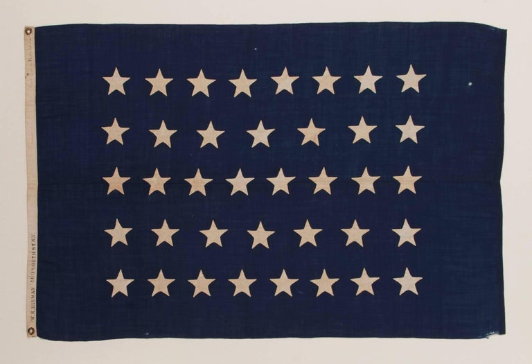 ANTIQUE AMERICAN U.S. NAVY JACK WITH 38 HAND-SEWN STARS AND A RARE MAKER'S MARK OF FLAG AND SAILMAKER W. K. HINMAN OF NEW YORK CITY, FLOWN ON THE YACHT