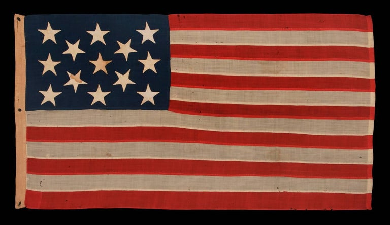 13 stars on a U.S. Navy small boat ensign, entirely hand-sewn, probably made between 1882 and 1884, a beautiful example in a remarkable state of preservation:  Despite the fact that America hasn't been comprised of 13 states since 1791, 13 star