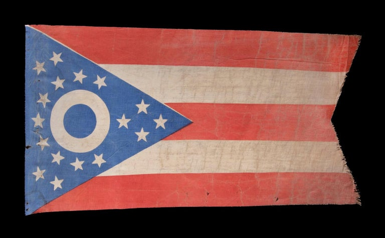 Early Ohio state flag with a blue disc inside the buckeye, circa 1902-1915, an extremely rare and beautiful example:  Early state flags fall between very scarce and extraordinarily rare in the antiques marketplace. One primary reason for this is