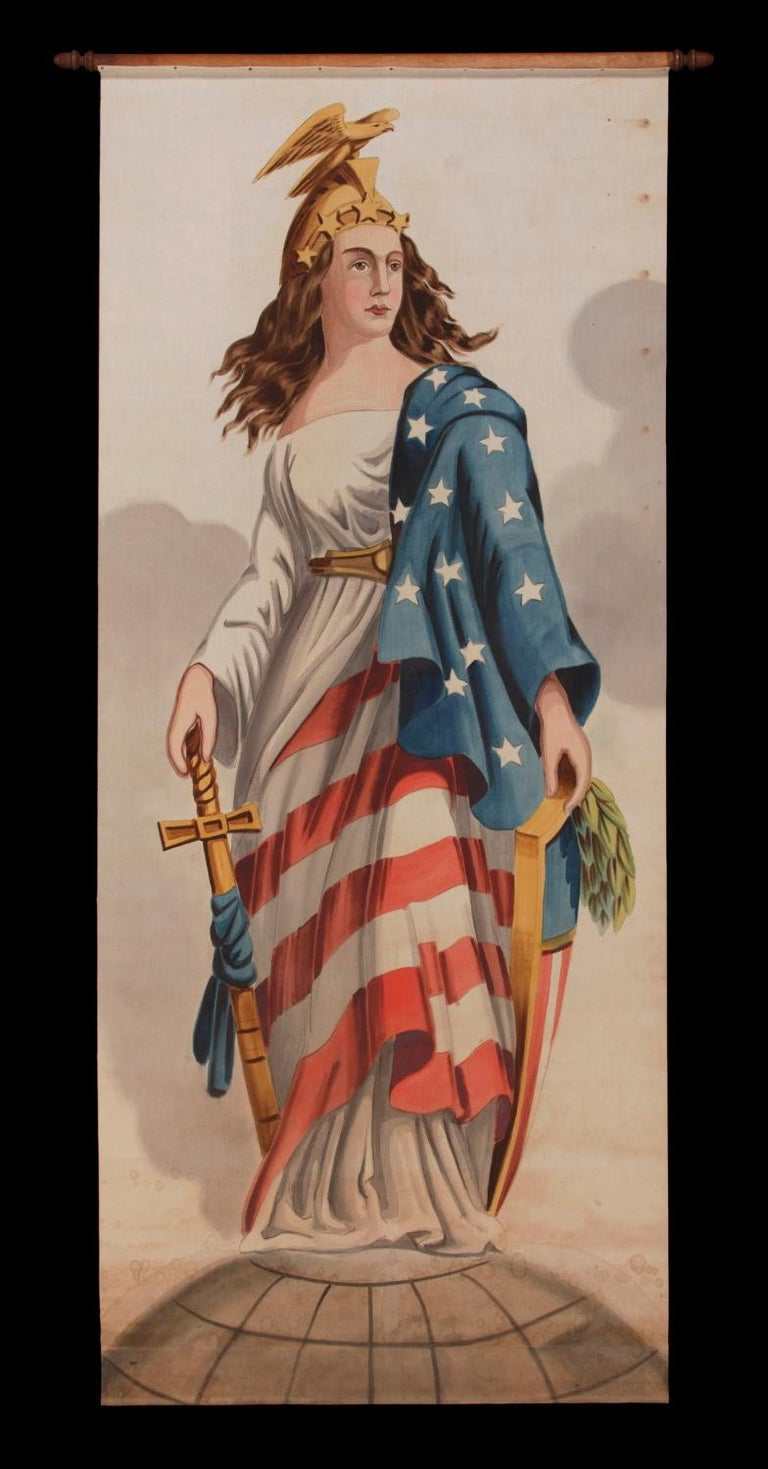 LADY COLUMBIA SURMOUNTING THE GLOBE WITH SHEATHED SWORD AND FEDERAL SHIELD, DRAPED IN THE AMERICAN FLAG AND CROWNED WITH A FIGHTING EAGLE AND STARS; A HAND-PAINTED BANNER OF MONUMENTAL SCALE, LAST QUARTER 19TH CENTURY   Patriotic banner,