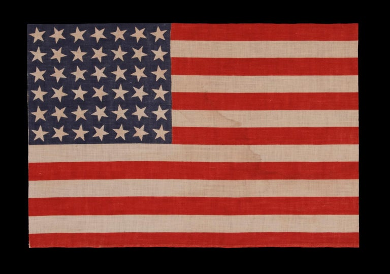 42 stars, an unofficial star count, on an antique American flag with scattered star positioning, 1889-1890, Washington Statehood: