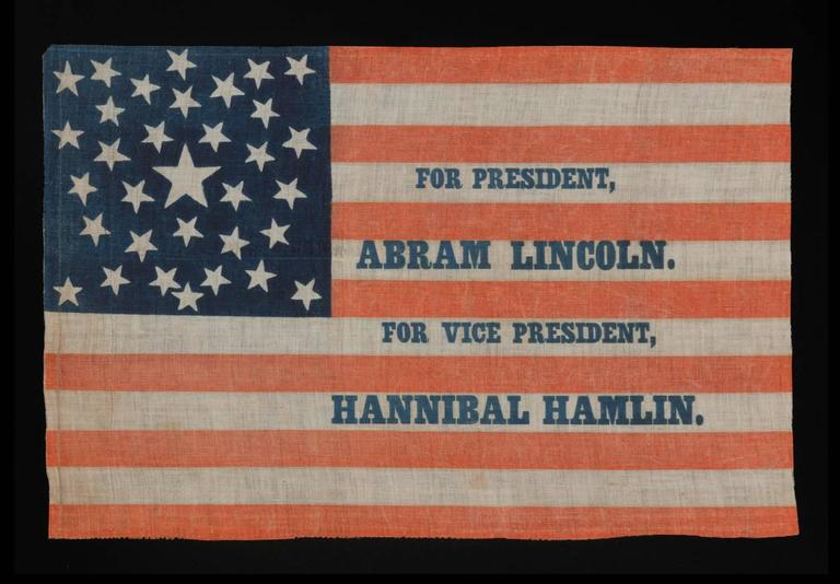 1860 CAMPAIGN PARADE FLAG WITH 33 STARS IN A PENTAGON MEDALLION AND AN INTRIGUING ABBREVIATION OF LINCOLN'S NAME, ATTRIBUTED TO H.C. HOWARD, PHILADELPHIA    33 star American parade flag with the 1860 Republican ticket printed in blue along the