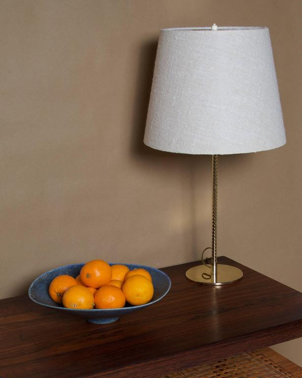 PAAVO TYNELL  Table Lamp, model nr. 9205  Taito Oy, Helsinki, Finland Brass, wool fabric shade. Height 59.5 cm, diameter 32 cm.  Table lamp by Paavo Tynell with spiral brass column, model nr. 9205. Manufactured by Taito Oy, Helsinki,