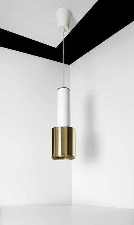Pendant light by architect Alvar Aalto, Model A110.  Rare version of the model with a solid brass shade.   Finland, circa 1950s. Early production, manufactured by Valaistustyö Ky. Impressed with maker´s mark {Valaistustyö} and model number