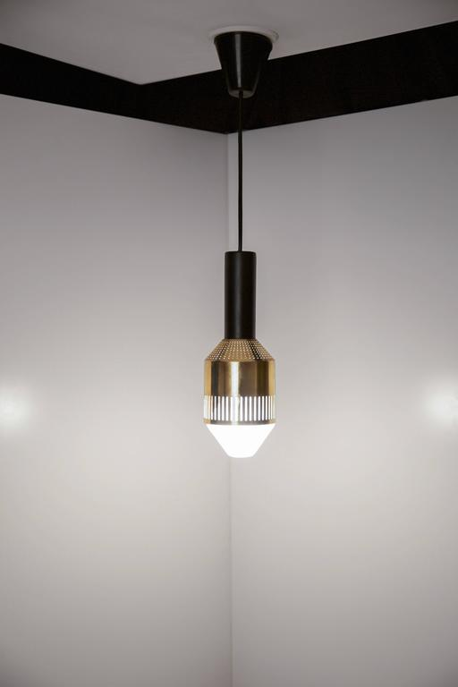 """Rare ceiling lamp by Tapio Wirkkala with perforated brass shade and satin lacquered metal body, designed between 1959-1961.  The model is from a limited edition or a custom-made model, carries label """"Original Tapio Wirkkala"""