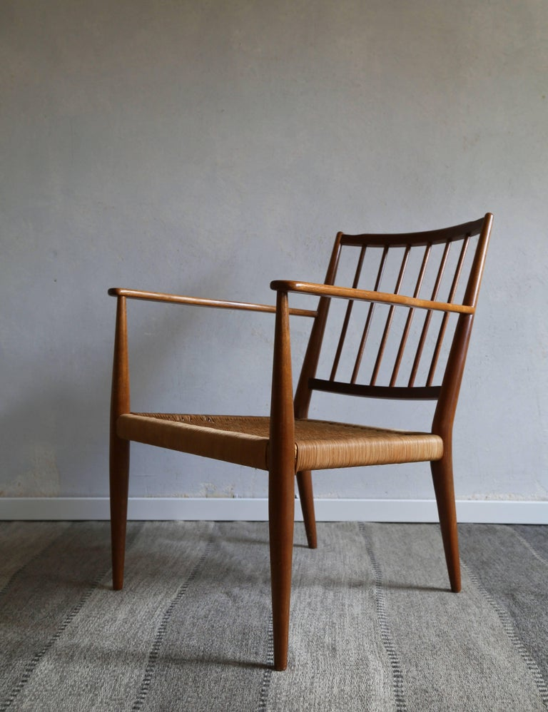Armchair by Swedish/Austrian designer and architect Josef Frank, Model No.508.  Designed in 1932 and manufactured by Firma Svenskt Tenn, Sweden, circa 1950s.  Unusual model, last production 1960s. Material mahogany and wicker.  Good condition