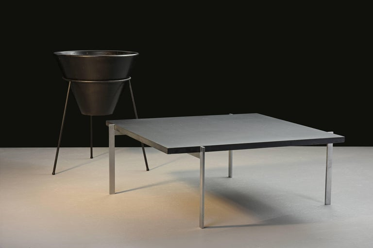 Poul Kjærholm, Model PK 61 table with black slate top  E. Kold Christensen. Denmark, 1956. Slate, chrome-plated steel. Measures: 33.5 W x 33.5 D x 12.75 H inches.  Earlyexample with manufacture's mark  Single estate ownership
