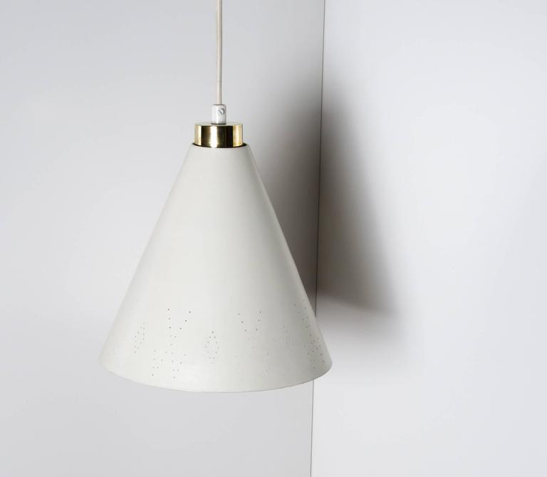 Perforated cone shaped ceiling lamp,