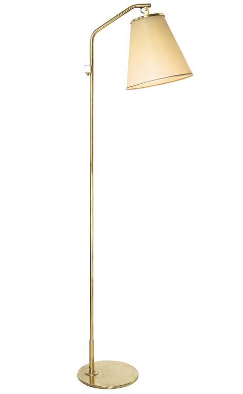 Paavo Tynell floor lamp model 9613  Taito Oy, Helsinki, Finland ca. 1940s  Brass, parchment shade.   Height 160 cm, depth 45 cm, width 29 cm.   Literature: Idman Lighting catalog no.135, pg 46 (Idman model no.9631).