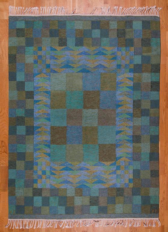 KARIN JÖNSSON   Flatweave Rug  Klockargårdens Hemslöjd, Tällberg, Sweden, ca.1960s Handwoven wool on a linen warp. Length ca.  265 cm, width 182 cm.  Handwoven wool rug with geometrical pattern by Swedish textile designer Karin Jönsson.