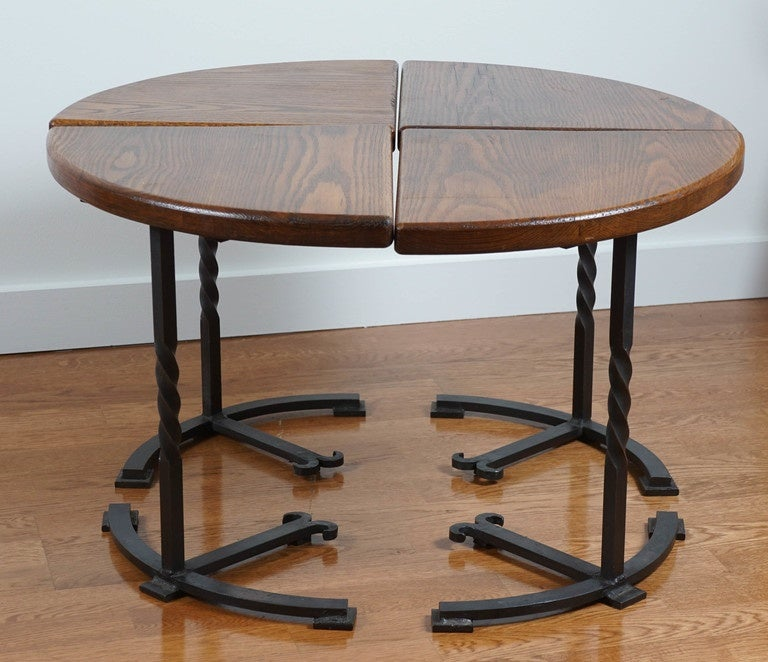 Four section, oak circular table, with interesting iron base. Comprised, of four separate side tables, that group together, forming a 30