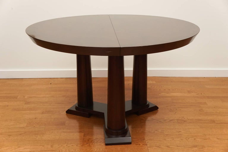 Wonderful, three column pedestal table, in a stained walnut veneer, with a 20