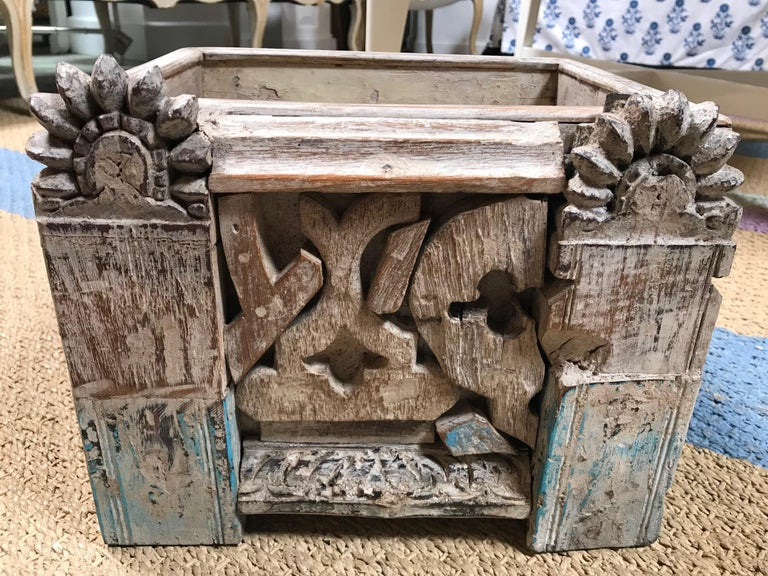 This sturdy box is slightly waxy to the touch. Giving light to the olden way of preserving carved wood. There are blue pieces to this box that give off a cultural and exotic feel. The front facade is pieced together with remnants of another life.