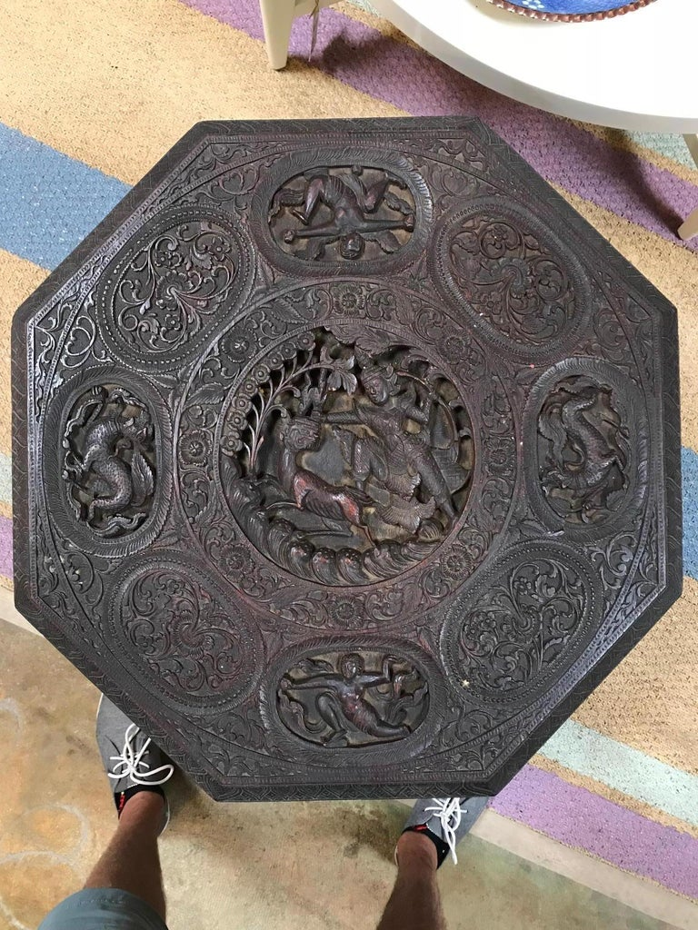 Indo-Chinese 19th century carved table, highly carved detailing.