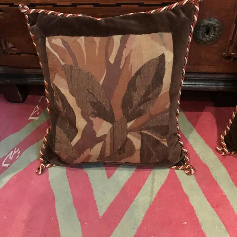 Set of four aubuson pillows.