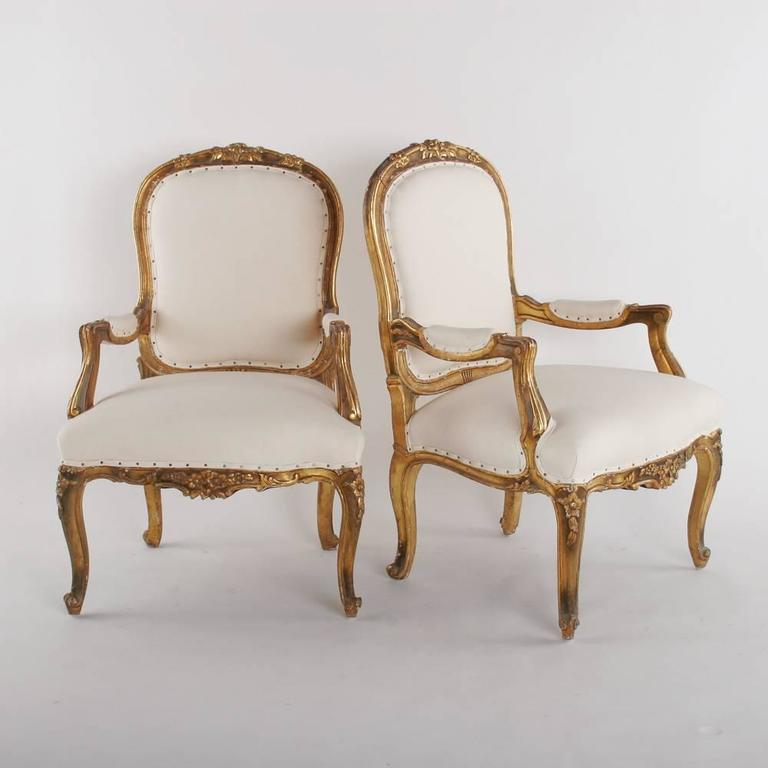 Carved and gilded pair of 19th century armchairs.