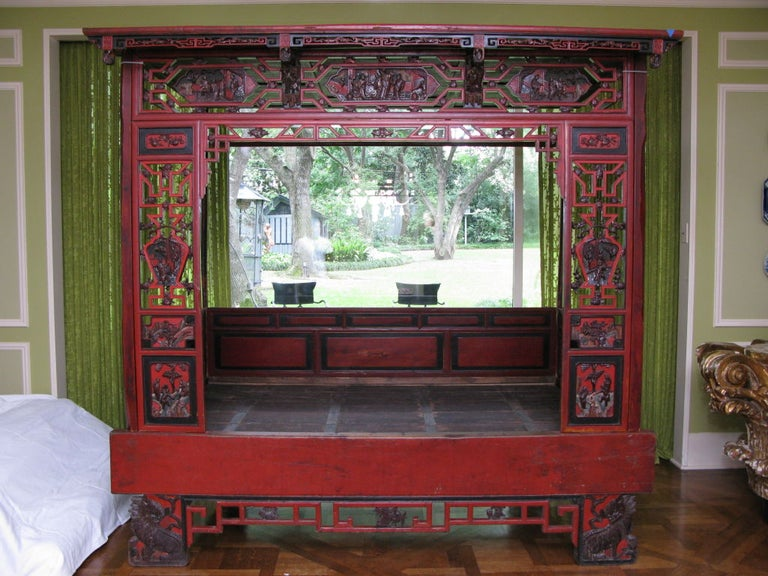 Chinese wedding bed in red lacquer and hand cards details. Has a new mattress (not shown).