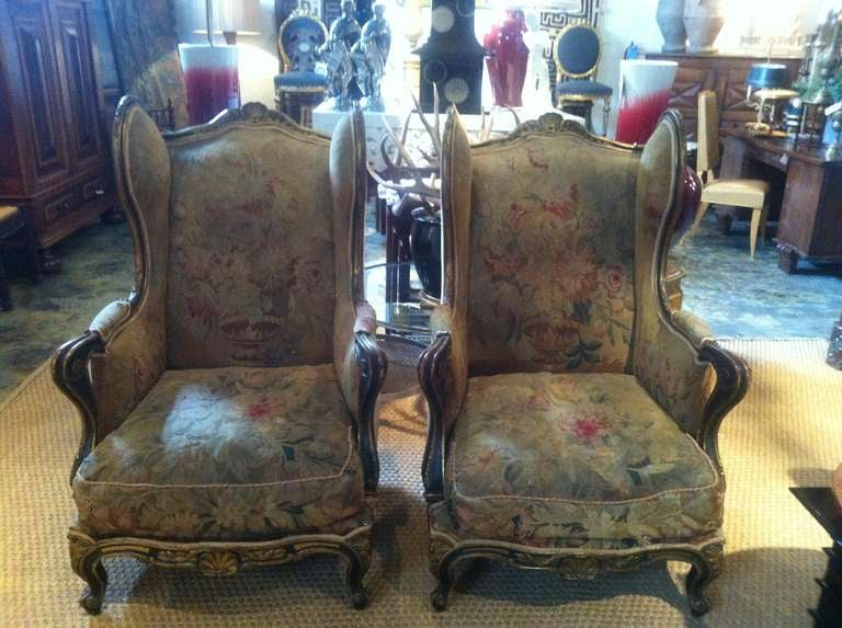 Pair of 19th century French chairs upholstered in an 18th century Aubusson fabric  Antique gold trim.