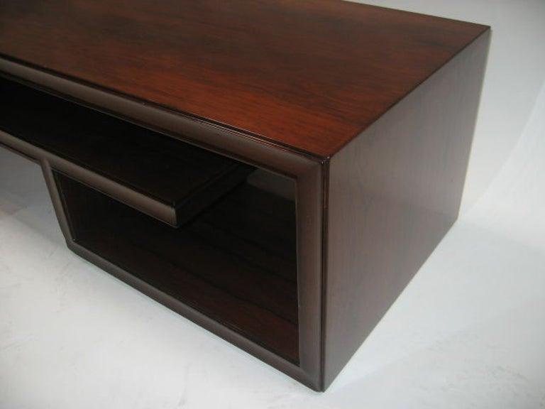 Greek Key design cocktail table. New French polish finish. Interior shelves.