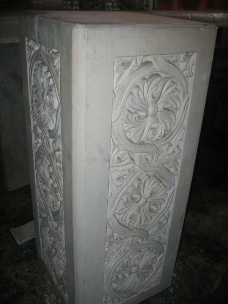 Vintage pair of plaster pedestals with ornate details of scrolls and acanthus leaves. Gothic in design.