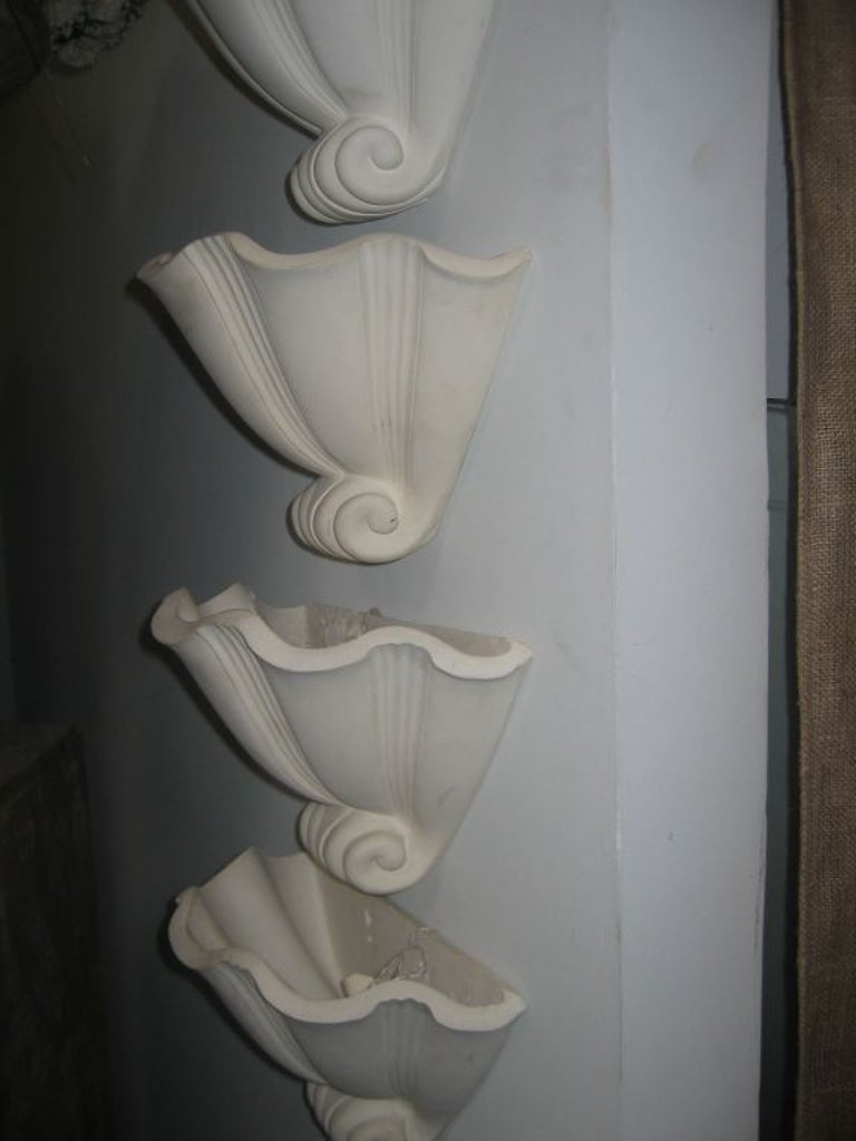 Set of four plaster wall sconces by Serge Roche.
