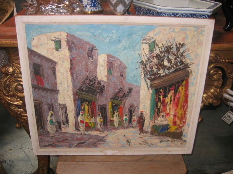 Vintage oil painting with bright color and rich texture. Realist work depicting a Moroccan street market. Beautiful light and shadow. Painting image is 23.5
