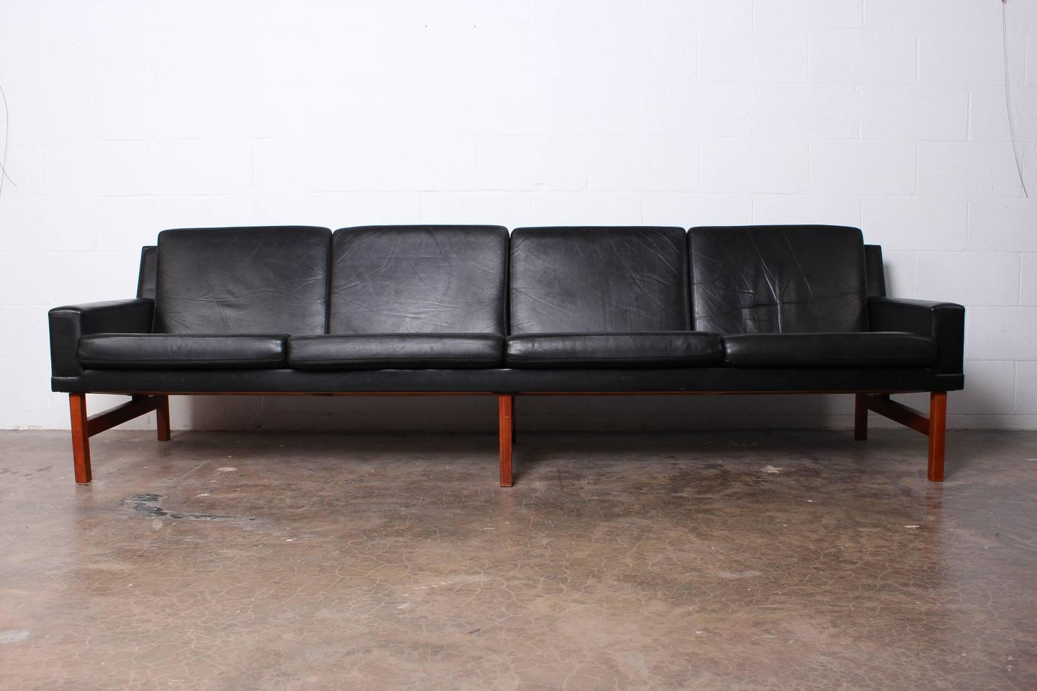 Long danish sofa in leather and teak for sale at 1stdibs for Long couches for sale