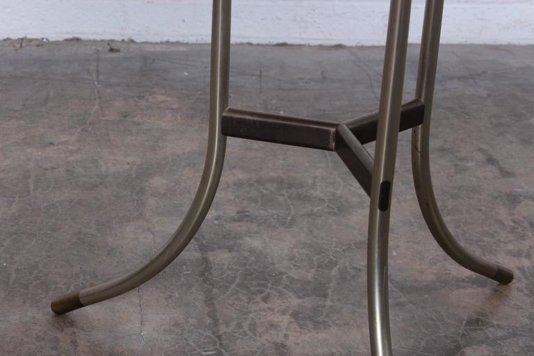A pair of Cedric Hartman side tables with bevelled granite tops.